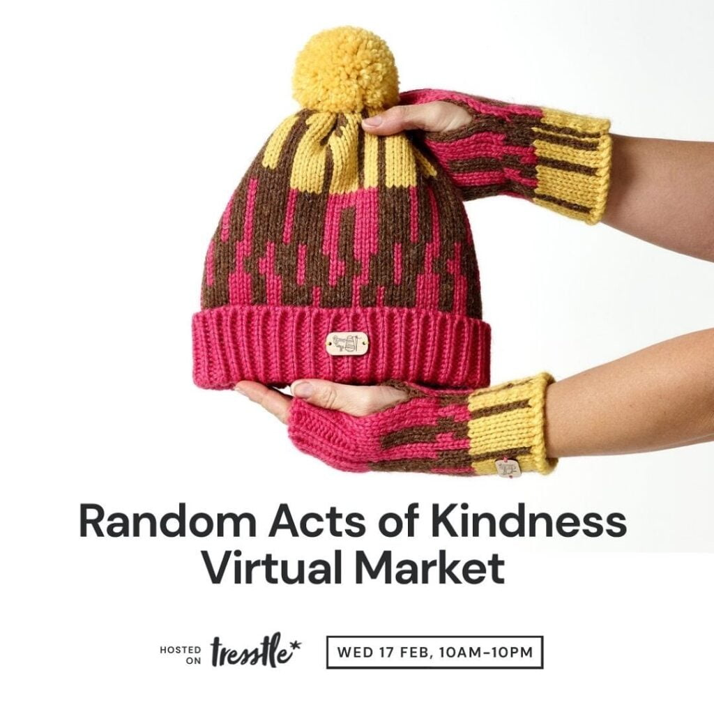 A promo image for Pedddle. The Random Actof Kindness Virtual Market. Wednesday 17th February. A pink, brown and mustard woollen knitted hat, being held by 2 hand wearing matching mittens.