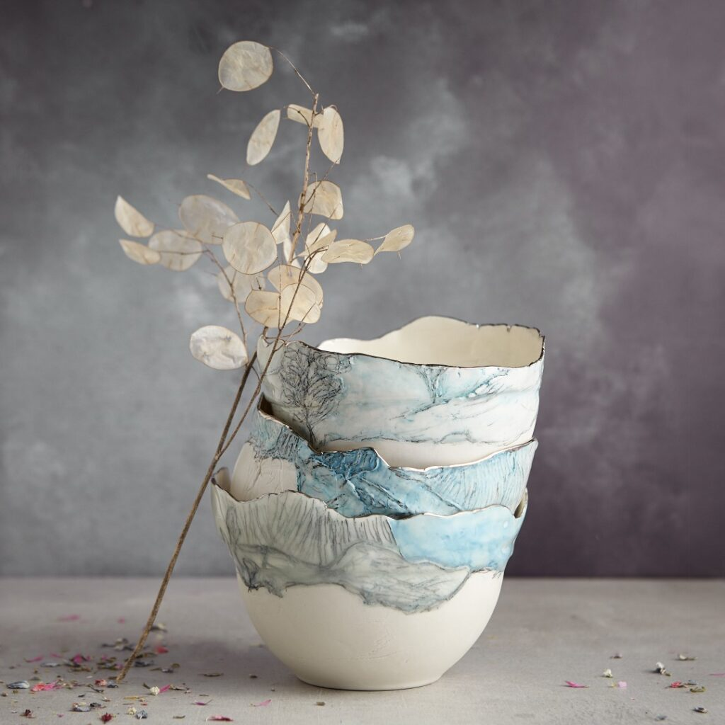 Stack of Porcelain Landscape Bowls with platinum rims, handcrafted by Nicola Briggs Ceramics