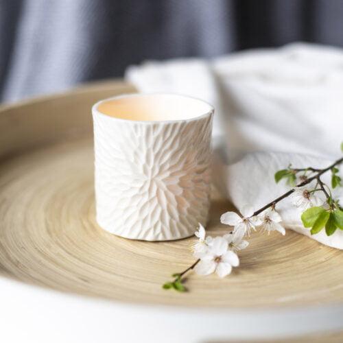 Porcelain tea light holder with carved surface like a dahlia