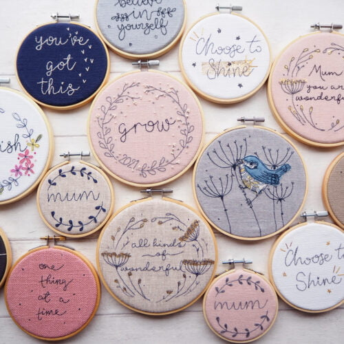 Thread Kind Co - a collection of motivational and positive hoops laid flat on a plain white board
