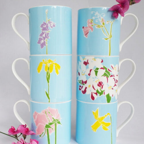six fine bone china flowers mugs, each featuring a different English flower against a blue background.