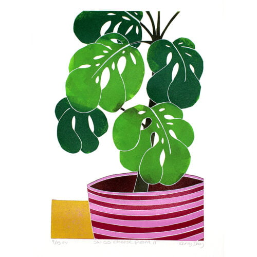 A colourful lino print of a swish cheese plant in a pink stripy plant pot sitting on a yellow surface