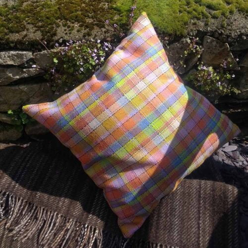 Ali Sharman Handweaver cushion in brightly coloured tweed