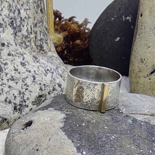 A fine Gold Line Wide Band Ring