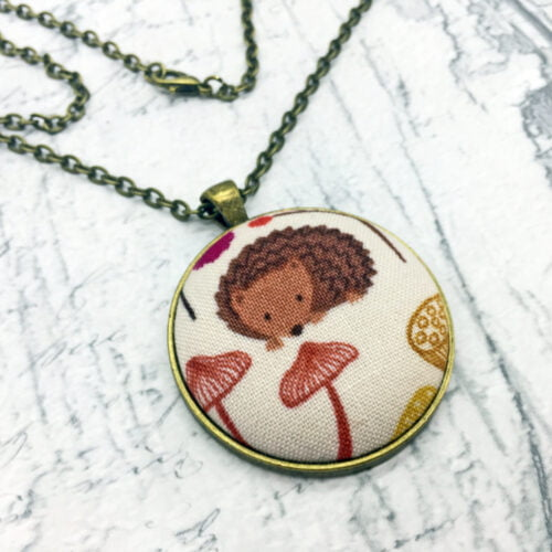 hedgehog pendant with toadstools by Bowerbird Jewellery