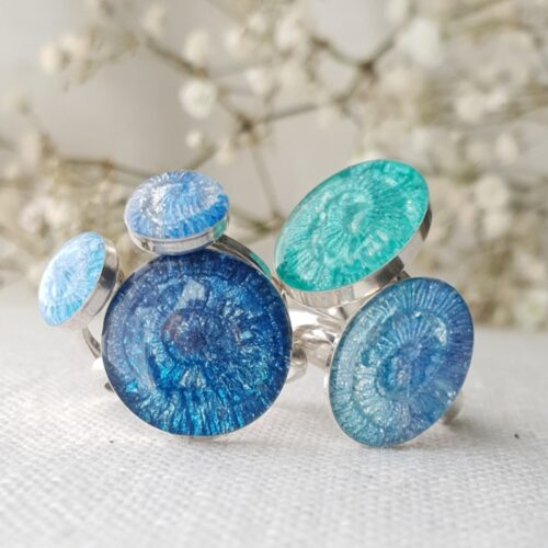 Group of blue and green handmade rings