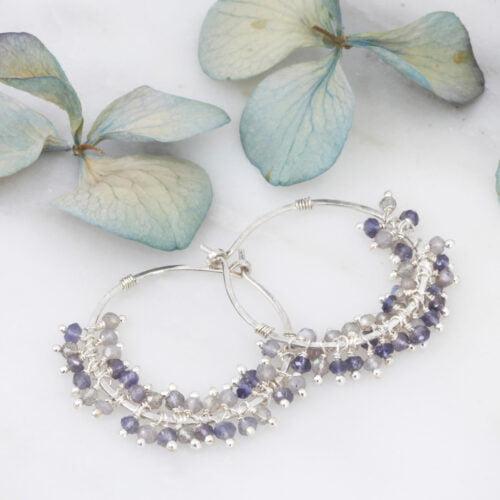 3 cm hammered sterling silver hoop earrings with clusters of grey & blue sparkling gemstones